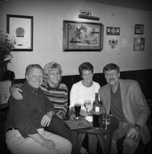 Ron and Crystal consulting with friends Steve and Sue in a London Pub